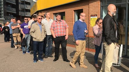 Over a hundred people queued outside the Carrow Road ticket office before it opened at 9am, but only
