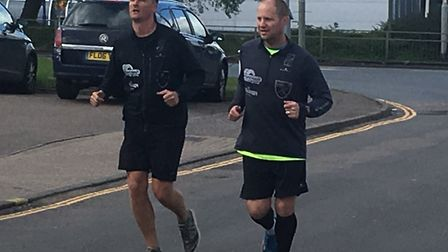 Jon Norman (left) and Lewis Blois finishing their 7in7 challenge. PIC: Peter Walsh.