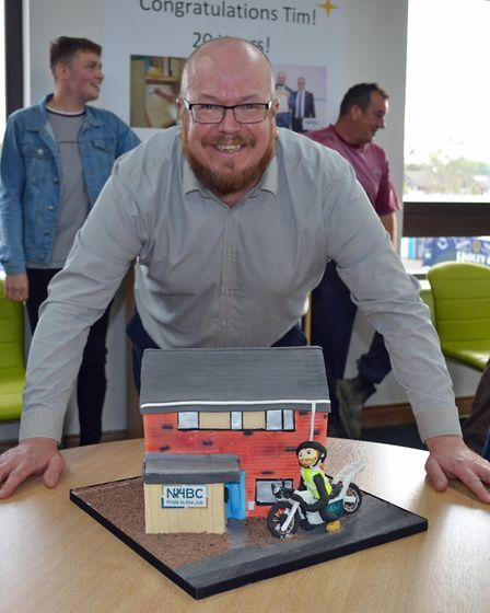 Tim Walsingham with his cake celebrating 20 years. Picture: Abel Homes