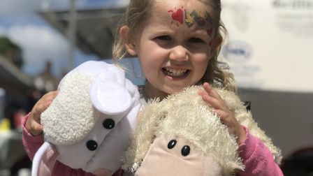 Scarlett Mendham-Webb, 4 from Feltwell enjoying a family day out at the Swaffham Sheep Fair. Picture