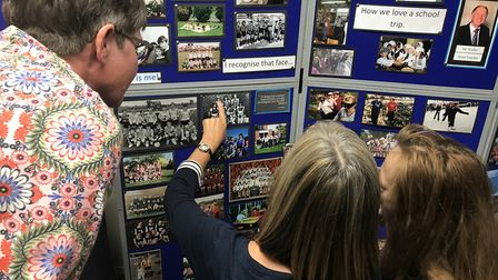 Former pupils reminisce over old photographs at Falcon Junior school's 50th birthday celebrations. P