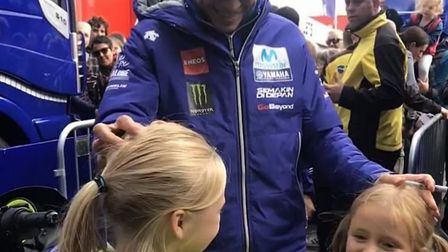 Izzy Carter and her sister Leia meeting Valentino Rossi. Picture: Mini Ross