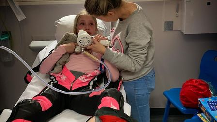 Izzy Carter with mum Samantha after she broke her leg. Picture: Mini Rossi