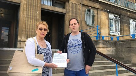 Lynn Lockhart and Matt Edwards delivering a petition about noise from Norwich venues at City Hall. P