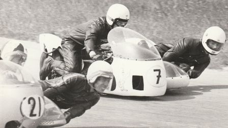 The Isle of Man TT is not for the faint-hearted. Sidecar passenger Mike Buxton is on the extreme rig