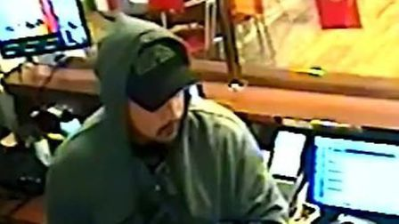 Police appealed for information to identify this man in connection to betting shop robbery. Picture: