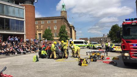 Students attend the fake 'car crash' outside The Forum in Norwich. Photo: Police and Crime Commissio