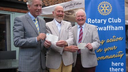 Cheques are handed over to Big C Norfolk and SSAFA after last year's Swaffham Rotary Charity Golf Da