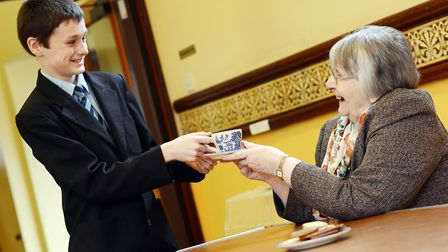 Thomas Cockman serves Jan Godfrey a cup of tea at a Wayland Academy coffee morning. Picture: Matthew