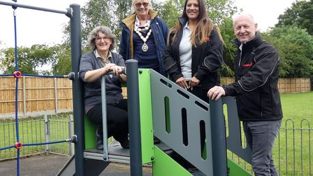 Sue Dent, Jill Skinner, Helen Sephton-Pike, Steve Sylvester with the new play equipment at Oaklands