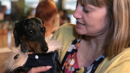 Sarah Allen, 38 from Necton wither dachshund Rosie at the pop-up cafe in Norwich. Picture: Neil Dids
