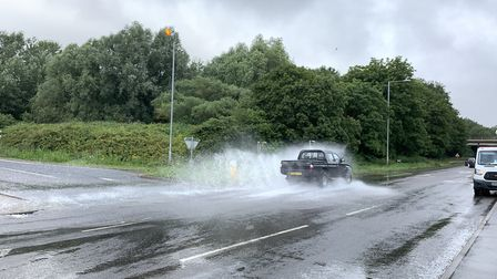Drivers embrace the flooding at the slip road with the A47, near Waitrose PICTURE: Matthew Farmer