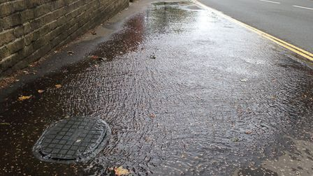 The water leak in Thorpe Road, Norwich, running downhill towards the railway station. Picture: Archa