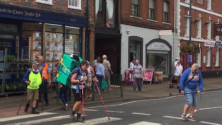 Charlie Houlder-Moat arriving in Watton with the crate on her back, Picture: Charlie Houlder-Mout
