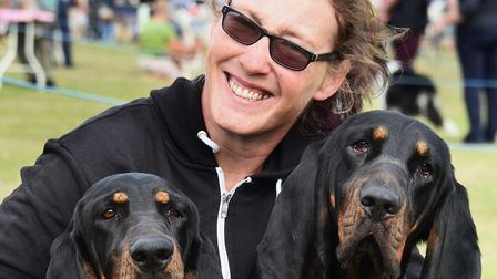 Kerry Nichols from Bungay with two black and tan coonhounds, two-year-old Dotty, left, and Agnes, 18