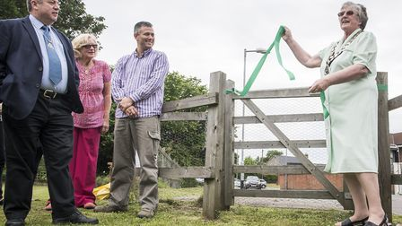 Former mayor Beryl Bunning (right) opens the garden, watched by guests and volunteers. Picture: Matt