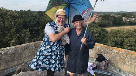 Paul Chubbok (dressed as Mary Poppins) and Paul Weatherill (dressed as a chimney sweep) on the roof