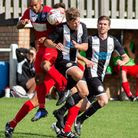 Sam Carter in aerial action against Woodbridge Town as Adrian Hill looks on Picture: EDDIE DEANE