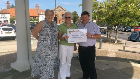 Sheila Lister and Colin Houghton present a cheque to Pam Tallon, winner of the Lucky Brochure draw a