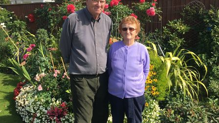 Norman and Wendy Brown in their garden in Woodpecker Drive which borders the new 177 home developmen