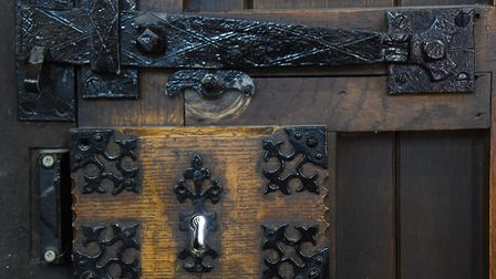 The ornate ironwork on one of the old doors to the 900-year-old Lazar House in Sprowston. Picture: D