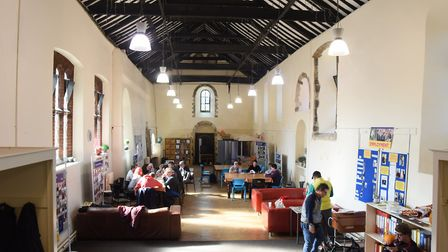 Assist Trust members at work inside the spacious 900-year-old Lazar House in Sprowston. Picture: DEN