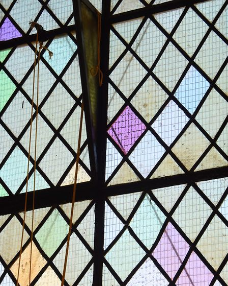 Coloured glass in one of the different style windows of the 900-year-old Lazar House in Sprowston. P