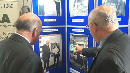 Swaffham Rotary president Stephen Ward shows Lord Dannatt some examples of the group's work. Picture