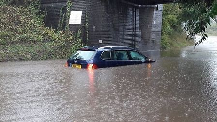 A car was stuck in the floods in Thorpe. Picture: Kim Bennett