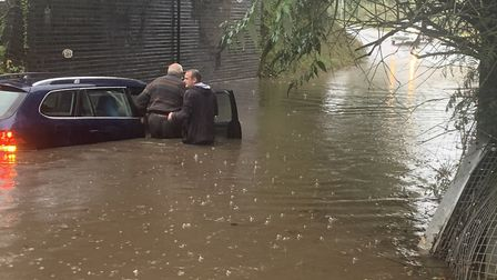 Man stuck in flooded water in Thorpe. Picture: Kim Bennett