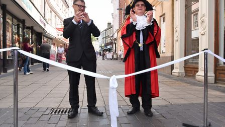 Mike Stonard, left, hosts a celebration of the 50th anniversary of London Street being pedestrianise