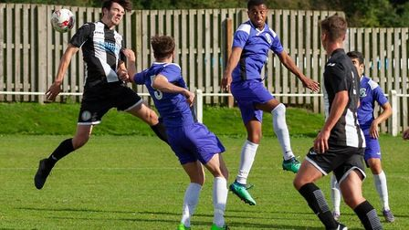 Matthew Prudence in the thick of the action for Swaffham Town against Whitton on Saturday Picture: E