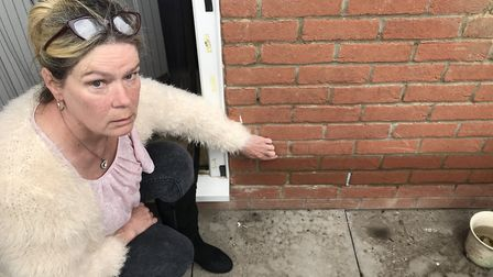 Carole Roughley points out how high flood water reached at her home in Pikeman Place, Thorpe St Andr