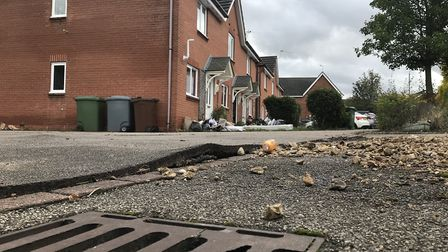 Damaged pavement in Pikeman Place, Thorpe St Andrew, where houses were flooded. Picture: Lauren De B