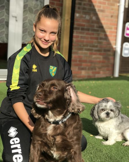 Tilly-Rose Dade with her dogs Sparky and Maisie. Picture: Victoria Pertusa