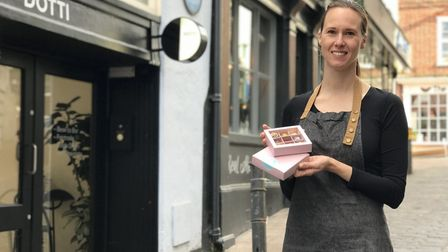 Dotti Chocolates owner, Hannah Winter outside her new shop on Bedford Street, Norwich. Picture: Neil