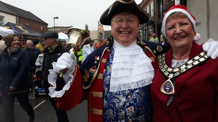 Watton Town Crier Mike Wabe and Mayor of the town Pat Warwick at Watton's festive Christmas market a