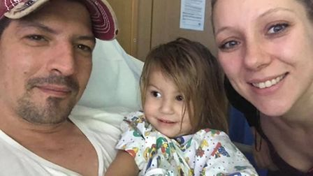 Esme Lambert with her mum and dad after she was first admitted to hospital. Photo: Lambert Family