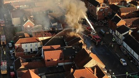 Footage captured by Sinclair Maynard shows the extent of the fire in Watton High Street. Picture: Si