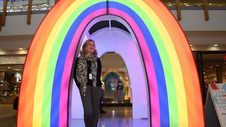 Marketing manager, Sheridan Smith, with the rainbow Happy House, one of the light houses at intu Cha