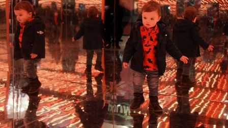 Noah Dumitrescu, 18-months-old, stepping carefully inside one of the light houses, the Energiser Hou