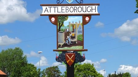 A town sign in Attleborough showing cider making. Cider making was an important part of Attleborough