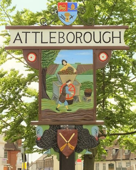 The town sign at Queen's Square in Attleborough, showing turkeys, cider making and brooms. Picture: