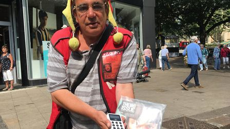 Big Issue seller Simon Gravell, 51, who is using a card reader after discovering fewer people are us