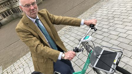 Norfolk County councillor Martin Wilby on one of the new Beryl bikes. Picture: Lauren De Boise.
