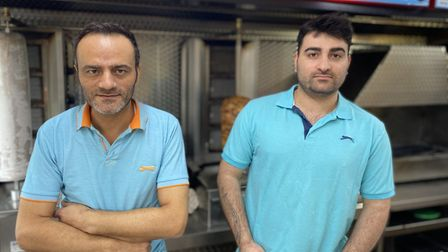 Okan Ucar, Atlantis Fish Bar manager, and his Chef Ozzy Oscar, fed firefigthters during a blaze whi
