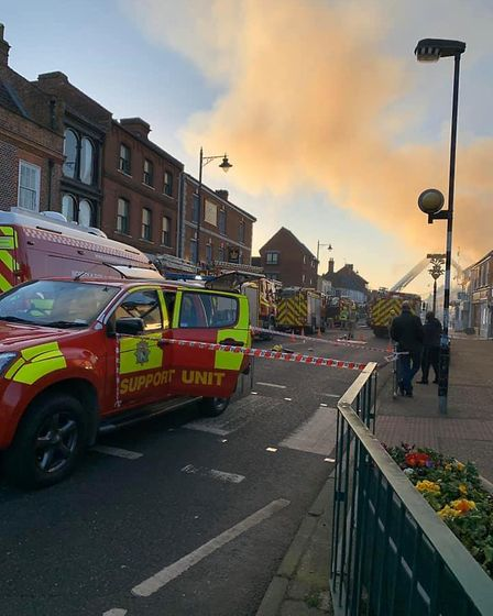 Firefighters worked hard to tackle a blaze which destroyed businesses on Watton high street. Photo: