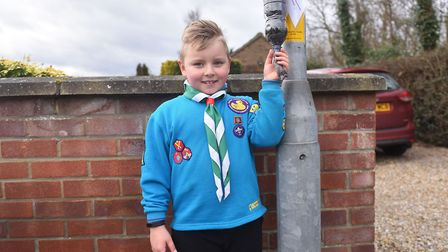 Thomas Gibson, 7, from Costessey, and his mum Rachel Gibson next to a home made emergency dog poo ba