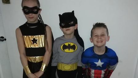Sonny Pope-Saunders, six, (right) with his brother Hudson Pope-Saunders, seven, and sister Star Pope