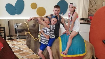 Sonny Pope-Saunders, six, (centre), with his sister Star Pope-Saunders, 10, brother Hudson Pope-Saun
